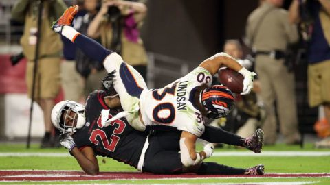 GLENDALE, AZ - OCTOBER 18: Running back Phillip Lindsay #30 of the Denver Broncos scores a 28-yard touchdown over defensive back Bene' Benwikere #23 of the Arizona Cardinals during the third quarter at State Farm Stadium on October 18, 2018 in Glendale, Arizona. (Photo by Christian Petersen/Getty Images)