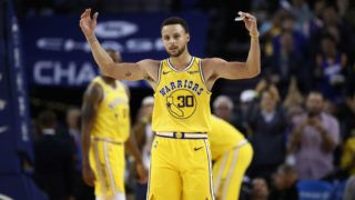 """OAKLAND, CA - OCTOBER 24:  Stephen Curry #30 of the Golden State Warriors reacts to the crowd chanting """"MVP"""" during their game against the Washington Wizards at ORACLE Arena on October 24, 2018 in Oakland, California. Curry finished the game with 51 points.   NOTE TO USER: User expressly acknowledges and agrees that, by downloading and or using this photograph, User is consenting to the terms and conditions of the Getty Images License Agreement.  (Photo by Ezra Shaw/Getty Images)"""