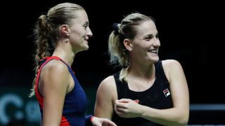 SINGAPORE - OCTOBER 27:  Kristina Mladenovic of France and Timea Babos of Hungary  play Ashleigh Barty of Australia and CoCo Vandeweghe of the United States in the Women's doubles semi final match on Day 7 of the BNP Paribas WTA Finals Singapore presented by SC Global at Singapore Sports Hub on October 27, 2018 in Singapore.  (Photo by Yong Teck Lim/Getty Images for the WTA)