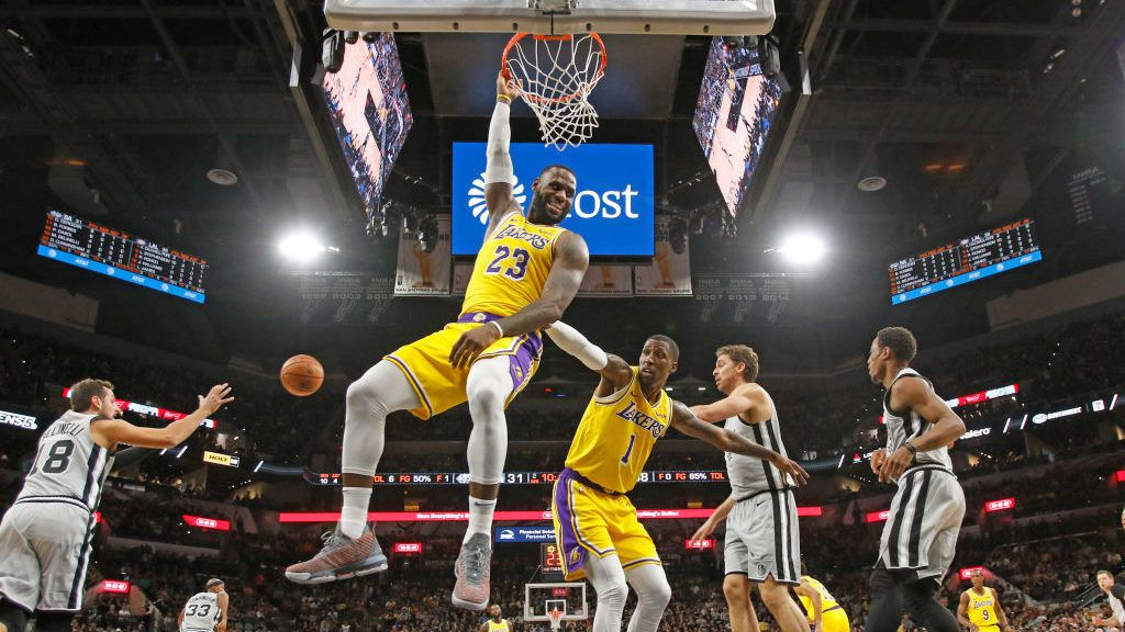 SAN ANTONIO,TX - OCTOBER 27:  LeBron James #23 of the Los Angeles Lakers hangs onto the rim after a turnover at AT&T Center on October 27 , 2018  in San Antonio, Texas.  NOTE TO USER: User expressly acknowledges and agrees that , by downloading and or using this photograph, User is consenting to the terms and conditions of the Getty Images License Agreement. (Photo by Ronald Cortes/Getty Images)