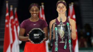 SINGAPORE - OCTOBER 28:  Elina Svitolina of the Ukraine poses with the Billie Jean King trophy and Sloane Stephens of the United States with her runner up trophy after the Women's singles final match on Day 8 of the BNP Paribas WTA Finals Singapore presented by SC Global at Singapore Sports Hub on October 28, 2018 in Singapore.  (Photo by Matthew Stockman/Getty Images)