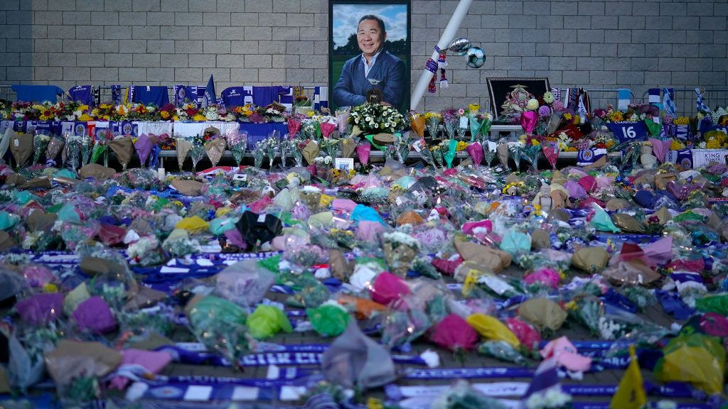 LEICESTER, ENGLAND - OCTOBER 29: A portrait of Leicester City Football Club's Thai chairman Vichai Srivaddhanaprabha who died in a helicopter crash, looks out over a sea of tributes  at Leicester City Football Club's King Power Stadium on October 28, 2018 in Leicester, England. The owner of Leicester City Football Club, Vichai Srivaddhanaprabha, was among the five people who died in the helicopter crash on Saturday evening after the club's game against  West Ham. (Photo by Christopher Furlong/Getty Images)