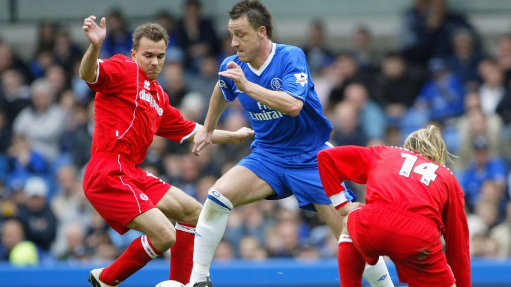 LONDON - APRIL 10:  John Terry of Chelsea battles for the ball with Szilard Nemith (L) and Giazka Mendieta of Middlesbrough during the FA Barclaycard Premiership match between Chelsea and Middlesbrough at Stamford Bridge on April 10, 2004 in London.  (Photo by Clive Mason/Getty Images)