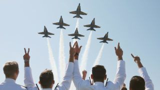 ANNAPOLIS, MD - MAY 22: The U.S. Navy Blue Angels fly over graduation ceremonies at the U.S. Naval Academy May 22, 2015 in Annapolis, Maryland. U.S. Vice President Joseph Biden will give the commencement speech to this year's graduating class.  (Photo by Mark Wilson/Getty Images)