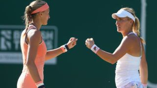 BIRMINGHAM, ENGLAND - JUNE 23: Kristina Mladenovic of France and Timea Babos of Hungary (R) talk tactics during their doubles Final match against Elise Mertens of Belgium and Demi Schuurs of the Netherlands during day nine of the Nature Valley Classic at Edgbaston Priory Club on June 24, 2018 in Birmingham, United Kingdom. (Photo by Jordan Mansfield/Getty Images for LTA)