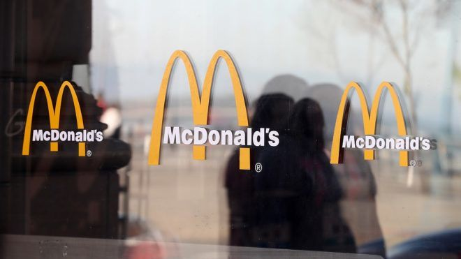 SAN FRANCISCO, CA - JANUARY 30: The McDonald's logo is displayed on the window of a McDonald's restaurant on January 30, 2018 in San Francisco, California. McDonald's reported better-than-expected fourth quarter earnings with global same-store sales growing at the fastest pace in six years. Fourth quarter net income dropped 41 percent to $698.7 million, or 87 cents per share, compared to $1.19 billion, or $1.44 per share one year ago.   Justin Sullivan/Getty Images/AFP