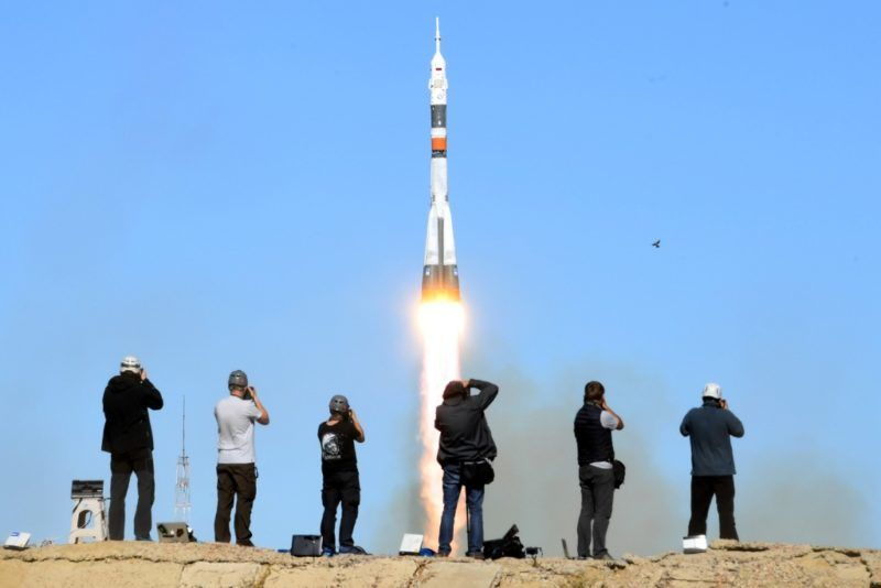 Photographers take pictures as Russia's Soyuz MS-10 spacecraft carrying the members of the International Space Station (ISS) expedition 57/58, Russian cosmonaut Alexey Ovchinin and NASA astronaut Nick Hague, blasts off to the ISS from the launch pad at the Russian-leased Baikonur cosmodrome in Baikonur on October 11, 2018. (Photo by Kirill KUDRYAVTSEV / AFP)