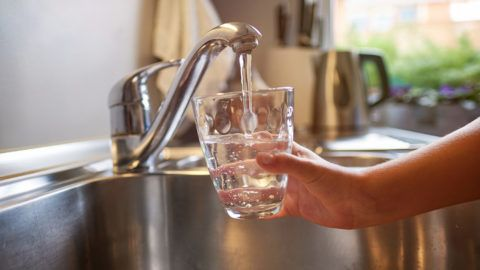 Pouring Fresh Tap Water Into a Glass