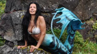 "Lisa posing on the rocks. SINCE discovering a lump in her breast this woman decided the key to survival was to become a raw vegan MERMAID and she feels she has reversed the aging process. University professor, Lisa (37), who goes by the alias, Raw Vegan Mermaid, from Ontario, Canada, had a health scare back in 2013 when doctors found a lump in her breast, and since then she's made it her goal to centre her life around her happiness and wellbeing. In April 2013, after doctors were concerned by what turned out to be a benign lump in her breast, Lisa decided she had to turn her health around by turning to veganism. Since leading a vegan lifestyle, Lisa has noticed drastic changes to her energy levels. She no longer suffers from the heartburn she had since the age of 12, and she says that she even feels younger in herself. Along with her vegan diet, Lisa's new lease of life is also thanks to her exercise regime and unusual hobby of ""mermaiding"", where she puts on her mermaid tail and swims either in pools or in the sea. @missjumpinjackfruit / mediadrumworld.com ***EXCLUSIVE***"