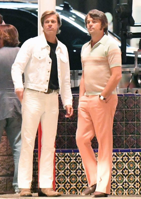 Leonardo DiCaprio sports a pair of tight pink pants while Brad Pitt wears an all white denim suit while filming night scenes with classic cars on the set of Once upon a time in Hollywood at Casa Vega on Ventura Blvd in Sherman Oaks, California on Monday night. Brad and Leo drove in a classic Cadillac while filming the scenes with Quinten Tarantino directing. 08 Oct 2018 Pictured: Brad Pitt and Leonardo Dicaprio. Photo credit: GAC/MEGA  TheMegaAgency.com +1 888 505 6342 October 8, 2018  *** Local Caption *** MEGA288823_001
