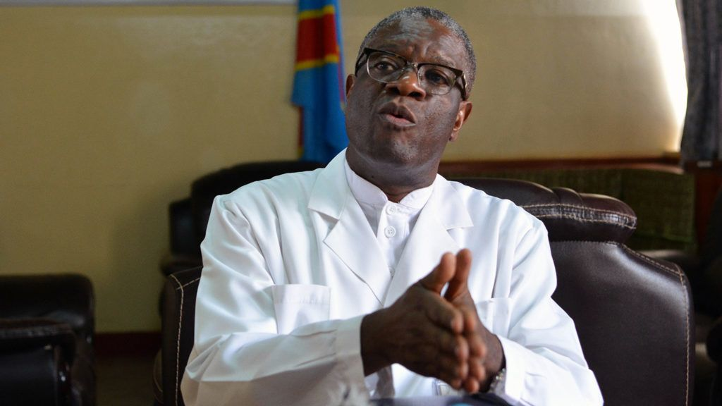 """Nobel Peace Prize winner Denis Mukwege talks to the press at the Panzi hospital in Bukavu, in the Democratic Republic of the Congo's South Kivu province, on October 6, 2018, a day after receiving the prestigious award. - Mukwege is a crusading gynaecologist who has spent more than two decades treating appalling injuries inflicted on women in DRC and his work was the subject of an acclaimed 2015 film titled: """"The Man Who Mends Women."""" (Photo by Alain WANDIMOYI / AFP)"""