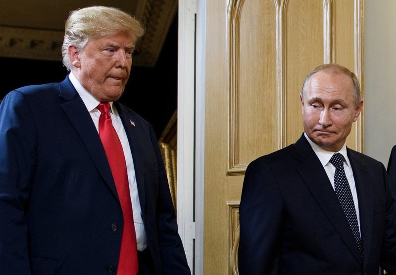 """(FILES) In this file photo taken on July 16, 2018 US President Donald Trump (L) and Russian President Vladimir Putin arrive for a meeting in Helsinki. - US President Donald Trump said November 5, 2018 he does not expect to hold talks with his Russian counterpart Vladimir Putin when they attend World War I commemorations in Paris at the end of this week. Trump said he was """"not sure we'll have a meeting in Paris -- probably not."""" However they """"will be meeting at the G20"""" summit in Argentina at the end of November, he said. (Photo by Brendan Smialowski / AFP)"""