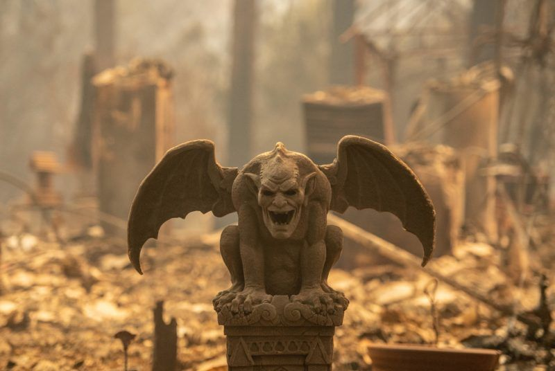 A gargoyle statue is seen among a property smoldering rubble in Paradise, north of Sacramento, California on November 09, 2018. - A rapidly spreading, late-season wildfire in northern California has burned 20,000 acres of land and prompted authorities to issue evacuation orders for thousands of people.  As many as 1000 homes, a hospital, a Safeway store and scores of other structures have burned in the area as the Camp fire tore through the region. (Photo by Josh Edelson / AFP)