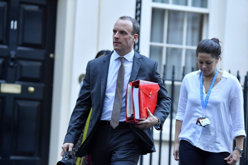 Britain's Secretary of State for Exiting the European Union (Brexit Minister) Dominic Raab leaves from 10 Downing Street in London on November 14, 2018. - British and European Union negotiators have reached a draft agreement on Brexit, Prime Minister Theresa May's office said on November 13. (Photo by Ben STANSALL / AFP)