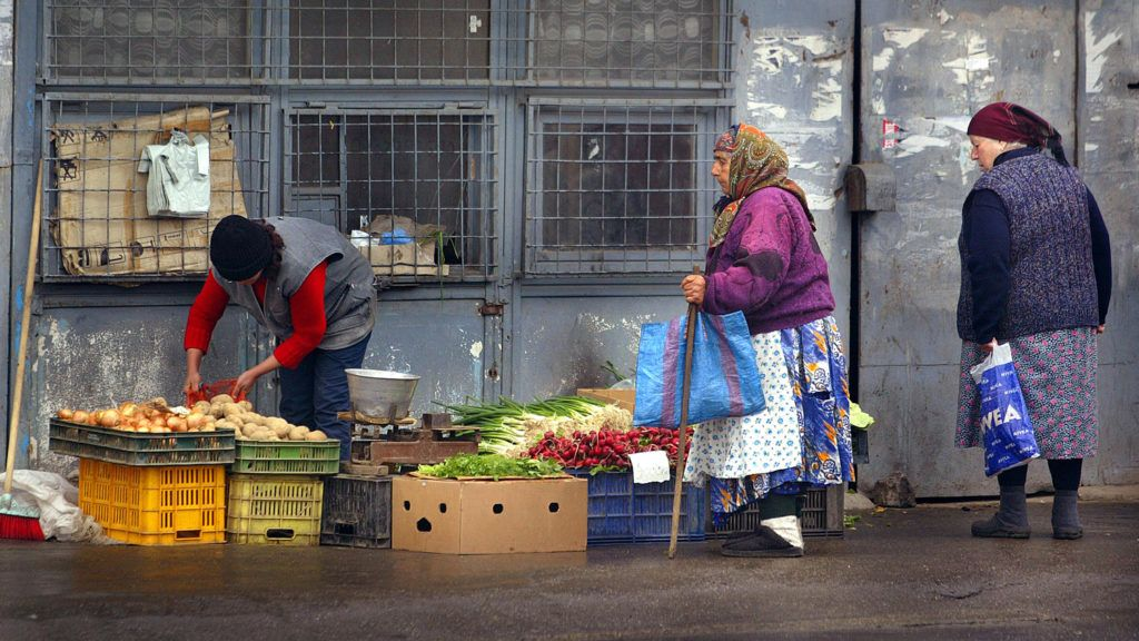 A Romanian woman sells vegetables on the street, in the Ferentari district of Bucharest, 19 April 2005. Romania considers itself on track to join the European Union in 2007 as European Parliament vote for the sign-up of adhesion treaty for Romania and Bulgaria scheduled on 25 April. Romania endured difficult transition after communism ended in 1989 and have struggled to dismantle the communist legacy. Romania's per-capita annual gross domestic product is $2,850 while the EU's poorest nation, Latvia, has $8,937. (Photo by DANIEL MIHAILESCU / AFP)