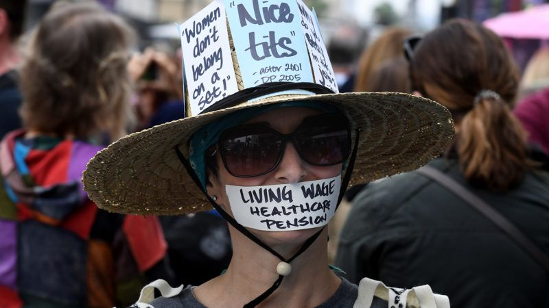 Victims of sexual harassment, sexual assault, sexual abuse and their supporters protest during a #MeToo march in Hollywood, California on November 12, 2017. - Several hundred women gathered in front of the Dolby Theatre in Hollywood before marching to the CNN building to hold a rally. (Photo by Mark RALSTON / AFP)