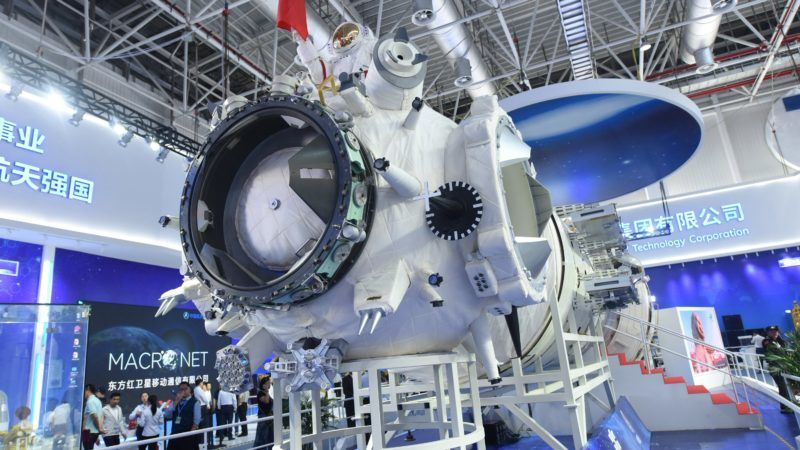 """A full-size model of the core module of China's space station Tianhe is displayed during the 12th China International Aviation and Aerospace Exhibition, also known as Airshow China 2018, in Zhuhai city, south China's Guangdong province, 7 November 2018.  The core module of the """"Tiangong,"""" China's planned space station, has been unveiled for the first time at the 12th China International Aviation and Aerospace Exhibition, or Airshow China 2018, in Zhuhai, Guangdong Province, November 6, 2018. The """"Tiangong"""" will be the """"heavenly temple"""" which will allow Chinese researchers to explore space through the national space laboratory. Officials anticipate """"Tiangong"""" should be completed sometime in 2022. The core module will mainly serve as the control and management aspect of the space station and for the astronauts' living conditions. It will have autonomous flight capability, support the astronauts' long-time stay in outer space and help them conduct experiments concerning aerospace medicine and space science. The in-orbit construction of the space station is expected to be completed around 2022. It will be the country's space lab in long-term stable in-orbit operation. The space station will consist of a core module and two experimental modules, each weighing about 20 tonnes. It will accommodate three to six astronauts. The designed lifespan of the space station is no less than 10 years, which can be extended by maintenance and repair work. The space station can be used to conduct space biology research and help cultivate fine species, probing disease mechanisms and biological medicine in order to improve people's health conditions."""