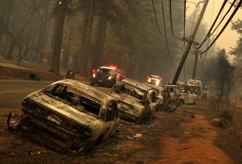 PARADISE, CA - NOVEMBER 09: A line of burned out abandoned cars sit on the road after the Camp Fire moved through the area on November 9, 2018 in Paradise, California. Fueled by high winds and low humidity, the rapidly spreading Camp Fire ripped through the town of Paradise and has quickly charred 70,000 acres and has destroyed numerous homes and businesses in a matter of hours. The fire is currently at five percent containment.   Justin Sullivan/Getty Images/AFP