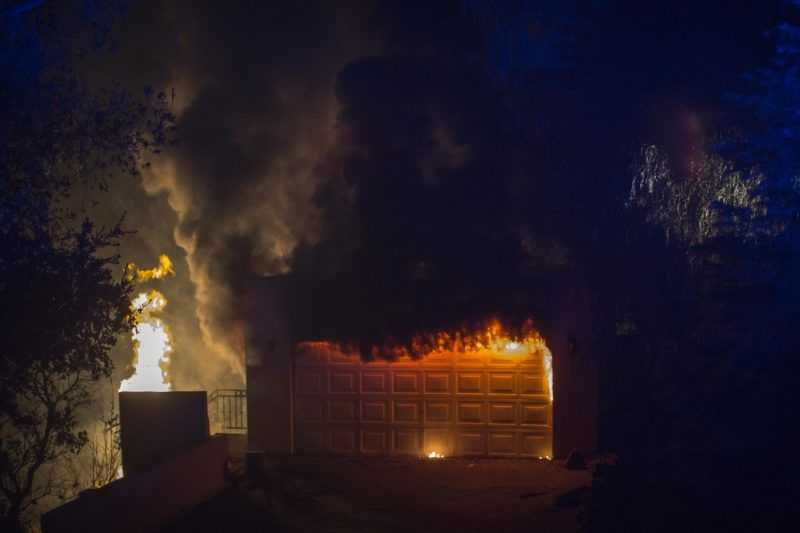 MALIBU, CA - NOVEMBER 09: A house burns during the Woolsey Fire on November 9, 2018 near Malibu, California. After a experiencing a mass shooting, residents of Thousand Oaks are threatened by the ignition of two nearby dangerous wildfires, including the Woolsey Fire which has reached the Pacific Coast at Malibu.   David McNew/Getty Images/AFP