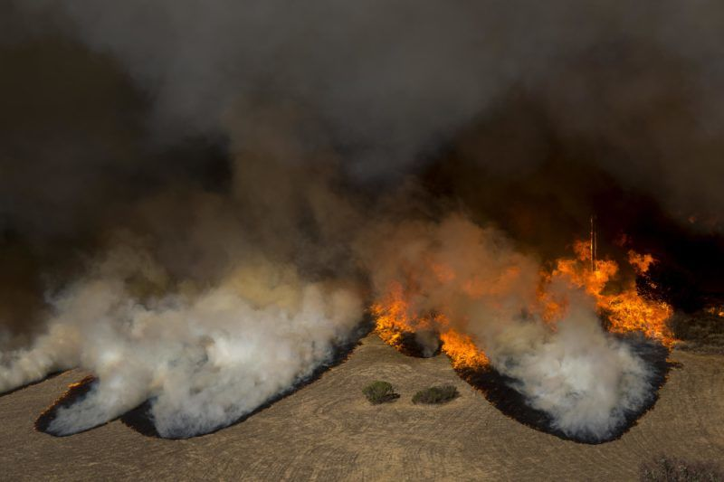 MALIBU, CA - NOVEMBER 09: Flames overtake the Reagan Ranch, once owned by President Ronald Reagan, at Malibu Creek State Park during the Woolsey Fire on November 9, 2018 near Malibu, California. After a experiencing a mass shooting, residents of Thousand Oaks are threatened by the ignition of two nearby dangerous wildfires, including the Woolsey Fire which has reached the Pacific Coast at Malibu.   David McNew/Getty Images/AFP
