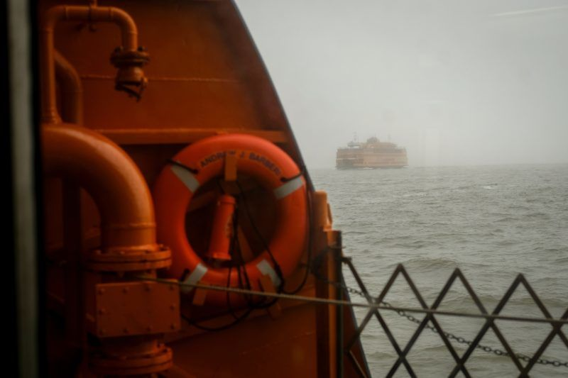 NEW YORK, NY - APRIL 25: A Staten Island Ferry passes another Staten Island Ferry as they travel through dense fog between Lower Manhattan and Staten Island, April 25, 2018 in New York City. According to the National Weather Service, New York Harbor and surrounding areas are under a dense fog advisory through Thursday morning.   Drew Angerer/Getty Images/AFP