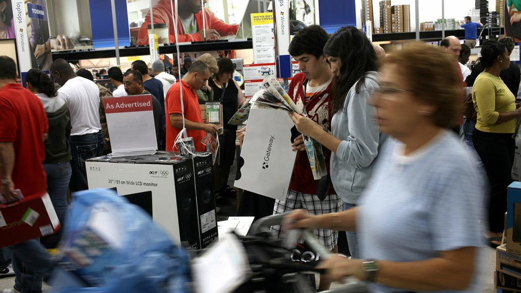 NAPLES, FL - NOVEMBER 26: Shoppers crowd a Best Buy store at dawn during Black Friday, the day after Thanksgiving which commences the holiday gift-buying season on November 26, 2010 in Naples, Florida. Hundreds of shoppers spent the night camped in front of the store to be the first ones in when doors opened at 5am. Black Friday typically features steep discounts on such favorite items as toys and electronics.   Spencer Platt/Getty Images/AFP