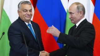 """Hungarian Prime Minister Viktor Orban (L) shakes hands with Russian President Vladimir Putin during their joint press conference following their meeting at the Kremlin in Moscow, on September 18, 2018. (Photo by Alexander Zemlianichenko / POOL / AFP) / """"The erroneous mention[s] appearing in the metadata of this photo by Alexander Zemlianichenko has been modified in AFP systems in the following manner: [POOL] instead of [SPUTNIK]. Please immediately remove the erroneous mention[s] from all your online services and delete it (them) from your servers. If you have been authorized by AFP to distribute it (them) to third parties, please ensure that the same actions are carried out by them. Failure to promptly comply with these instructions will entail liability on your part for any continued or post notification usage. Therefore we thank you very much for all your attention and prompt action. We are sorry for the inconvenience this notification may cause and remain at your disposal for any further information you may require."""""""