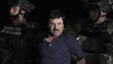 "(FILES) In this file photo taken on January 8, 2016, Drug kingpin Joaquin ""El Chapo"" Guzman is escorted into a helicopter at Mexico City's airport, following his recapture during an intense military operation in Los Mochis, in Sinaloa State. - Joaquin ""El Chapo"" Guzman goes on trial in New York on November 5, 2018 accused of running the world's biggest drug cartel and spending a quarter of a century smuggling more than 155 tons of cocaine into the United States. (Photo by ALFREDO ESTRELLA / AFP)"