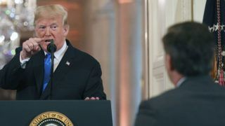 US President Donald Trump points to journalist Jim Acosta from CNN during a post-election press conference in the East Room of the White House in Washington, DC on November 7, 2018. (Photo by Jim WATSON / AFP)