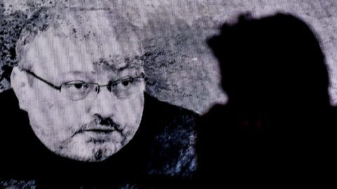 A man passes in front of a screen showing Jamal Khashoggi during a commemoration event of Khashoggi's supporters on November 11, 2018 in Istanbul. - US Secretary of State Mike Pompeo told Saudi Crown Prince Mohammed bin Salman on November 11, 2018 that the US will hold accountable all involved in killing a dissident Saudi journalist. (Photo by OZAN KOSE / AFP)