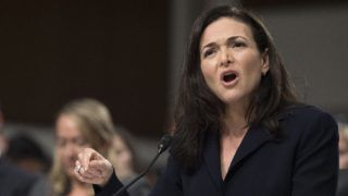 "(FILES) In this file photo taken on September 5, 2018, Facebook COO Sheryl Sandberg testifies before the Senate Intelligence Committee on Capitol Hill in Washington, DC. - Sandberg on on November 16, 2018, pledged a ""thorough"" review of a political consulting firm's work for the social network giant after one target criticized the techniques used as ""black ops."" Like founder Mark Zuckerberg, Sandberg has said she was unaware her firm was working with Definers Public Affairs, a Republican opposition research group. (Photo by Jim WATSON / AFP)"