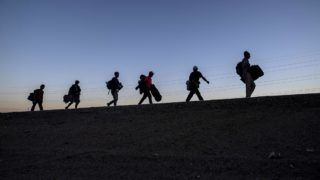 Central American migrants -mostly Hondurans- moving in a caravan towards the United States in hopes of a better life, head to Tijuana in Mexico's Baja California State, after leaving Mexicali on November 19, 2018. - US President Trump has sent about 5,800 troops to the border to forestall the arrival of large groups of Central American migrants travelling through Mexico and towards the US, in a move critics decry as a costly political stunt to galvanize supporters ahead of midterm elections earlier this month. (Photo by PEDRO PARDO / AFP)