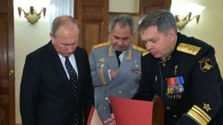 Fron L: Russian President Vladimir Putin, Defence Minister Sergei Shoigu and first deputy head of the Main Directorate of the General Staff of the Russian Armed Forces, vice admiral Igor Kostyukov attend the Military Intelligence Day during the event to mark the 100th anniversary from the establishment of the Russian Armed Forces' General Staff at the Russian Army Theatre in Moscow on November 2, 2018. (Photo by Alexey DRUZHININ / SPUTNIK / AFP)