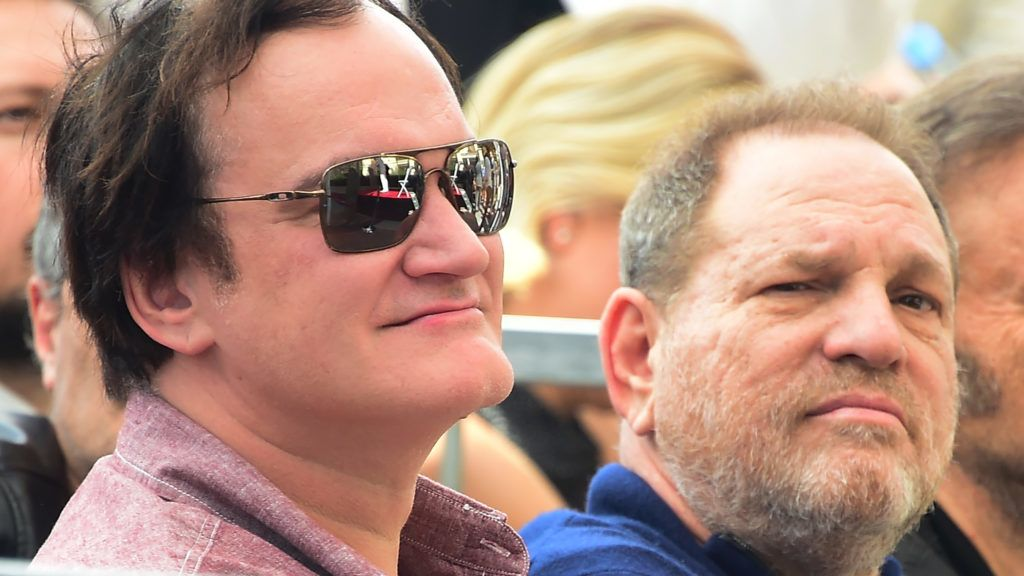 Film director Quentin Tarantino and producer Harvey Weinstein attend Italian composer Ennio Morricone's  Hollywood Walk of Fame Star ceremony on February 26, 2016 in Hollywood, California. - Morricone received the 2,574th Star on the walk of fame in the category of Live Performance/Theater. (Photo by FREDERIC J. BROWN / AFP)