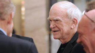 "Czech-born writer Milan Kundera (C) attends the 20th anniversary party of the French philosopher Bernard-Henri Levy's review ""La regle du jeu"" (The rules of the game) on November 30, 2010 in Paris. Founded in 1990 in Paris by writers the review had extanded its topics further than literature to artistic, cultural or politic debates such as leading a campaign in support to Sakineh Mohammadi-Ashtiani, an Iranian woman sentenced to death.  AFP PHOTO MIGUEL MEDINA (Photo by MIGUEL MEDINA / AFP)"