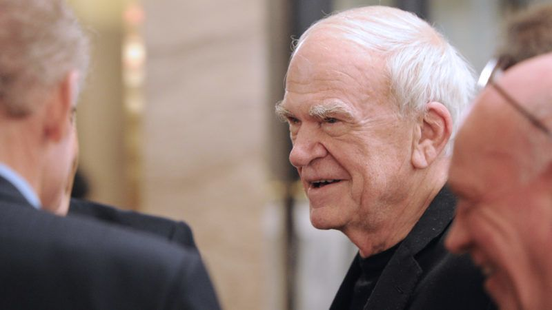 """Czech-born writer Milan Kundera (C) attends the 20th anniversary party of the French philosopher Bernard-Henri Levy's review """"La regle du jeu"""" (The rules of the game) on November 30, 2010 in Paris. Founded in 1990 in Paris by writers the review had extanded its topics further than literature to artistic, cultural or politic debates such as leading a campaign in support to Sakineh Mohammadi-Ashtiani, an Iranian woman sentenced to death.  AFP PHOTO MIGUEL MEDINA (Photo by MIGUEL MEDINA / AFP)"""