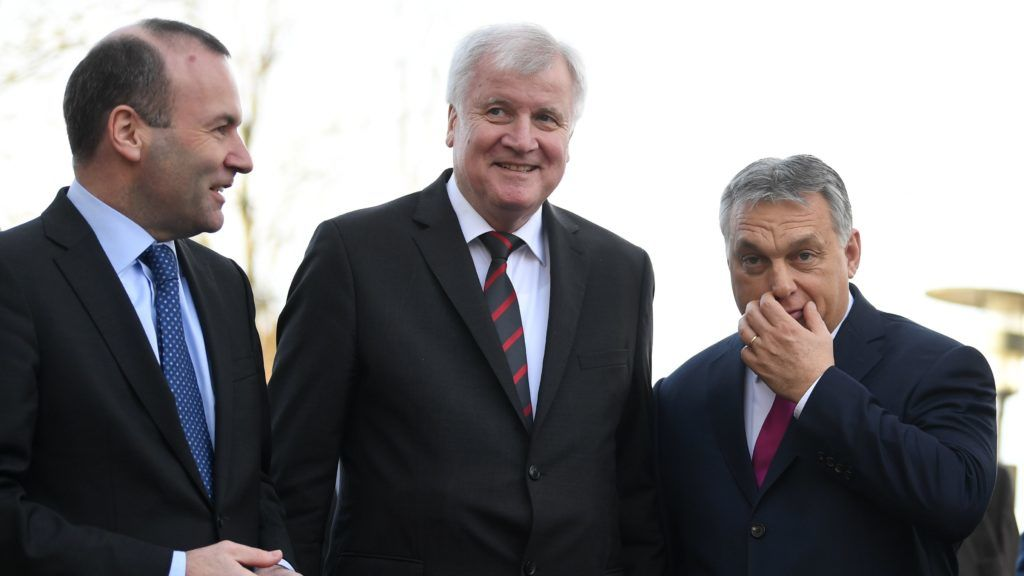 Leader of the German Christian Social Union Party (CSU) Horst Seehofer (L) and member of the European parliament Manfred Weber (L) welcome Prime Minister of Hungary Viktor Orban (R) on the second day of the CSU regional faction retreat in the Seeon Abbey on January 5, 2018 in southern Germany. - German Chancellor's Bavarian allies, the CSU, meet over exploratory talks with the Social Democrats on forming Germany's next government. (Photo by CHRISTOF STACHE / AFP)