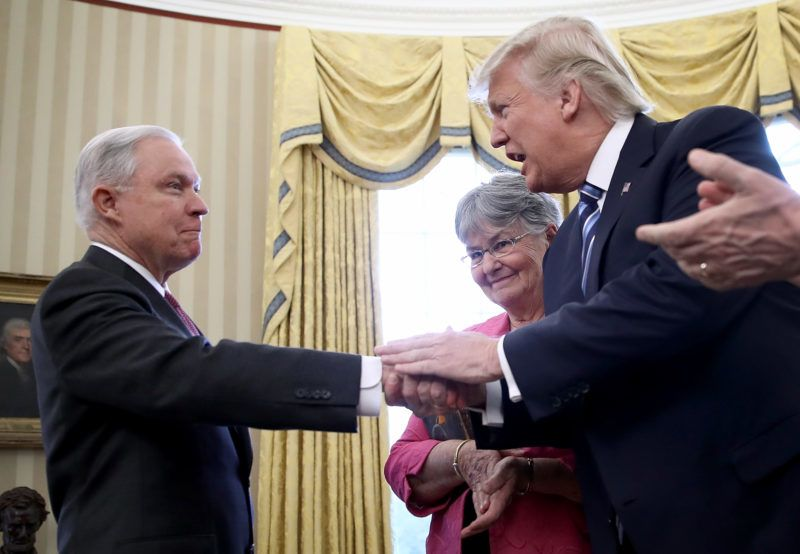 FILE - NOVEMBER 7, 2018: It has been reported that Jeff Sessions was asked to submit his resignation as U.S. Attorney General and Matthew G. Whitaker, Chief of Staff to Attorney General Jeff Sessions becomes the new acting Attorney General. WASHINGTON, DC - FEBRUARY 09: U.S. President Donald Trump (2nd R) shakes the hand of Jeff Sessions after Sessions was sworn in as the new U.S. Attorney General by U.S. Vice President Mike Pence (R) in the Oval Office of the White House February 9, 2017 in Washington, DC. Trump also signed three executive orders immediately after the swearing in ceremony. Also pictured is Sessions's wife, Mary (2nd L), holding the bible.   Win McNamee/Getty Images/AFP