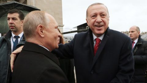 """PARIS, FRANCE - NOVEMBER 11: (----EDITORIAL USE ONLY – MANDATORY CREDIT - """"TURKISH PRESIDENCY / MURAT CETINMUHURDAR / HANDOUT"""" - NO MARKETING NO ADVERTISING CAMPAIGNS - DISTRIBUTED AS A SERVICE TO CLIENTS----) Turkish President Recep Tayyip Erdogan (R) and Russian President Vladimir Putin (L) meet as they participate in the commemorative ceremony within the centenary of the end of World War I, on November 11, 2018 near the Arc de Triomphe monument located in Champs-Elysees in Paris, France.  Turkish Presidency / Murat Cetinmuhurdar / Handout / Anadolu Agency"""