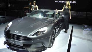 JAKARTA, INDONESIA - MARCH 18: Models pose near a Vanquish of Aston Martin during an opening ceremony of the luxury British sports car brand's first dealership in Jakarta, Indonesia, on 18 March 2015. Aston Martin is continuing its global expansion with the opening their first dealership in Jakarta, the luxury British sports carmaker now has 155 dealers in 45 countries worldwide. Arie Basuki / Anadolu Agency