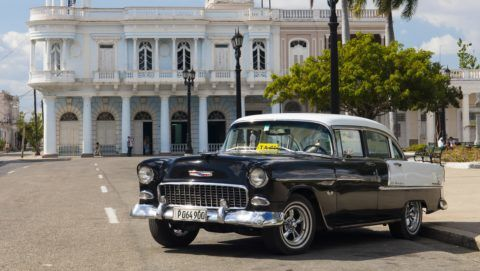 Black and white Chevrolet Bel Air by Plaza Jose Marti, Cienfuegos, UNESCO World Heritage Site, Cuba, West Indies, Caribbean, Central America