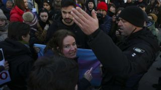 Policemen push rallying for transgender rights people towards the subway station to dispers people and stop the rally in Kyiv, Ukraine, November 18, 2018.  International day for the remembrance of transgender people is held around the world on November 18. (Photo by Sergii Kharchenko/NurPhoto)