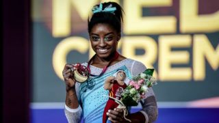 Simone Biles of United States with her goal medal at Individual Final for Women at the Aspire Dome in Doha, Qatar, Artistic FIG Gymnastics World Championships on 1 of November, 2018. (Photo by Ulrik Pedersen/NurPhoto via Getty Images)