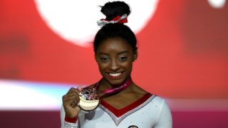 DOHA, QATAR - NOVEMBER 02:  Simone Biles of The United States celebrates her gold medal in the Vault exercise during day nine of the 2018 FIG Artistic Gymnastics Championships at Aspire Dome on November 2, 2018 in Doha, Qatar.  (Photo by Francois Nel/Getty Images)