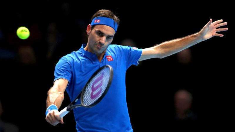 LONDON, ENGLAND - NOVEMBER 13:  Roger Federer of Switzerland plays a backhand during his singles round robin match against Dominic Thiem of Austria during Day Three of the Nitto ATP World Tour Finals at The O2 Arena on November 13, 2018 in London, England.  (Photo by Naomi Baker/Getty Images)