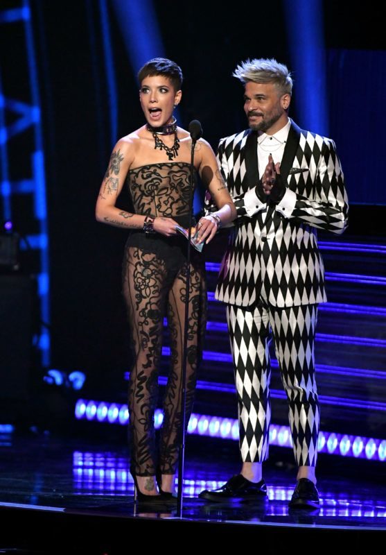 LAS VEGAS, NV - NOVEMBER 15:  Halsey (L) and Pedro Capo speak onstage during the 19th annual Latin GRAMMY Awards at MGM Grand Garden Arena on November 15, 2018 in Las Vegas, Nevada.  (Photo by Ethan Miller/Getty Images for LARAS)