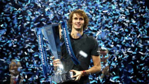 LONDON, ENGLAND - NOVEMBER 18:  Alexander Zverev of Germany celebrates victory with the trophy following the singles final against Novak Djokovic of Serbia during Day Eight of the Nitto ATP Finals at The O2 Arena on November 18, 2018 in London, England.  (Photo by Julian Finney/Getty Images)