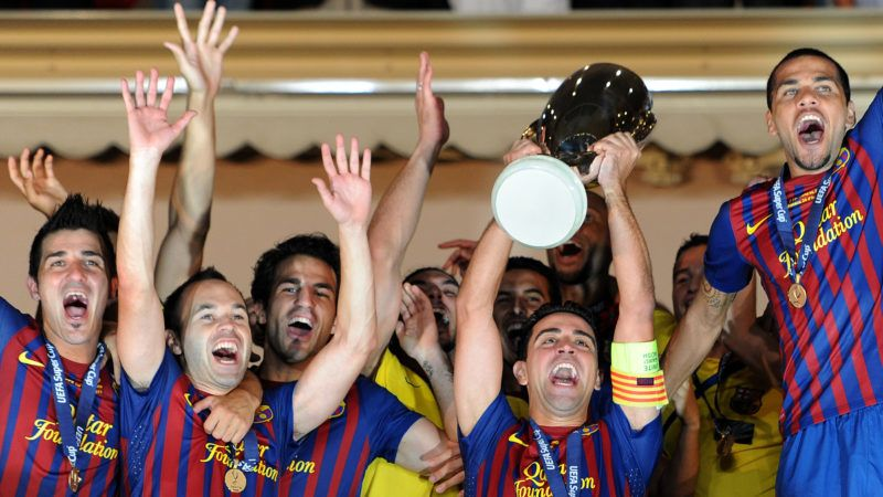 MONACO - AUGUST 26: Xavi Hernandez (2nd R) of FC Barcelona holds the trophy aloft amid his teammates David Villa (L), Andres Iniesta (2nd L), Cesc Fabregas (3rd L) and Daniel Alves during the UEFA Super Cup match between FC Barcelona and FC Porto at Louis II Stadium on August 26, 2011 in Monaco, Monaco.  (Photo by Jasper Juinen/Getty Images)