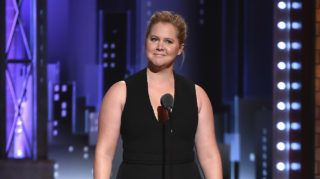 NEW YORK, NY - JUNE 10:  Amy Schumer speaks onstage during the 72nd Annual Tony Awards at Radio City Music Hall on June 10, 2018 in New York City.  (Photo by Theo Wargo/Getty Images for Tony Awards Productions)