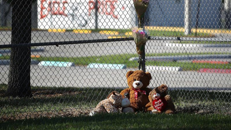 PARKLAND, FL - FEBRUARY 18: A memorial is seen at Marjory Stoneman Douglas High School on February 18, 2018 in Parkland, Florida. Police arrested 19 year old former student Nikolas Cruz for the mass shooting that killed 17 people on February 14.   Joe Raedle/Getty Images/AFP